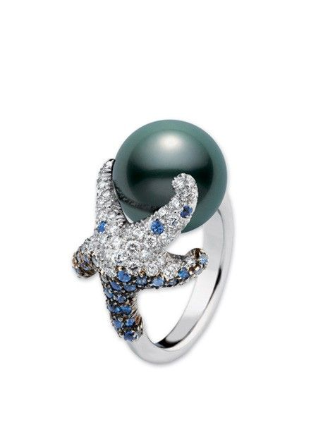 Mikimoto pearls are beautiful. I am in love with this ring. The blue reminds me of Starfish we would find back home.