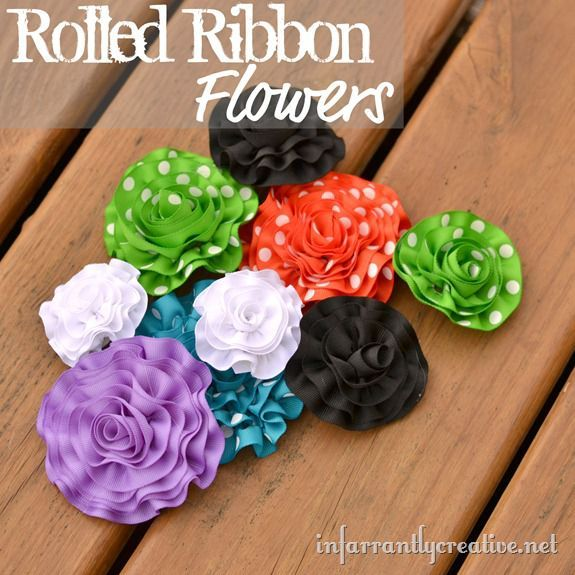 rolled ribbon-flowers - these use a ruffle foot for a sewing machine, but you can use a hand-sewn running stitch for the same effect.