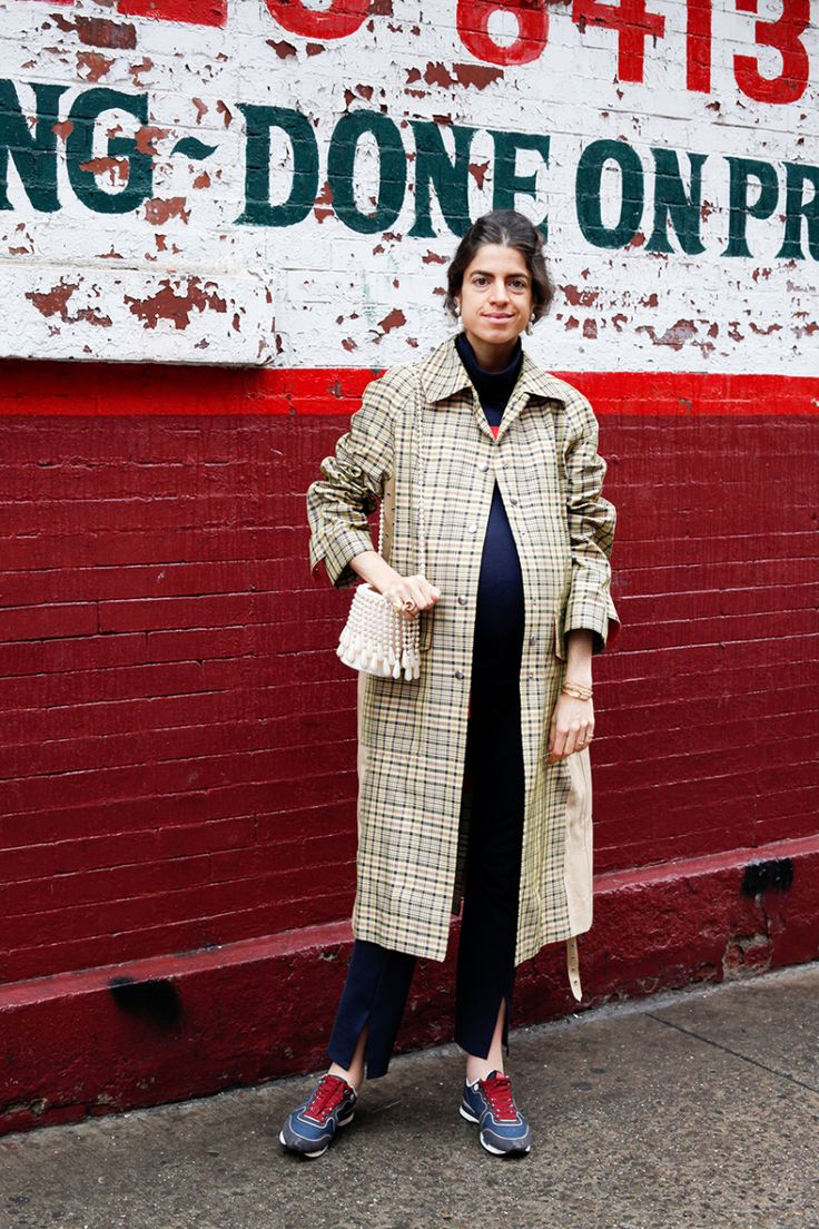 Wednesday, Leandra And for my next trick! The same pants I wore on Monday -- which I wear about four times a week (they have a stretchy waistband and make me feel so fancy, even when I am wearing them with swollen ankles and running sneakers) -- on Wednesday. This time with a navy blue turtleneck, plaid trench coat and a pair of Céline earrings I bought myself for my birthday in December. Lest I forget the bag! Also made of pearls.
