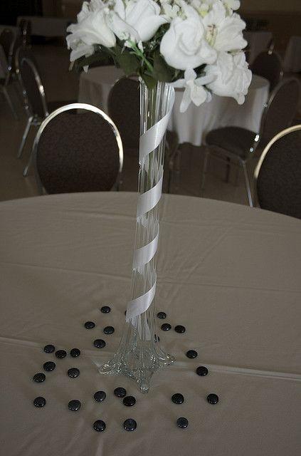 Ribbon around eiffel tower vase event planning