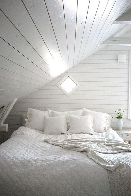 White attic bedroom - love the way the light is coming through the diamond window