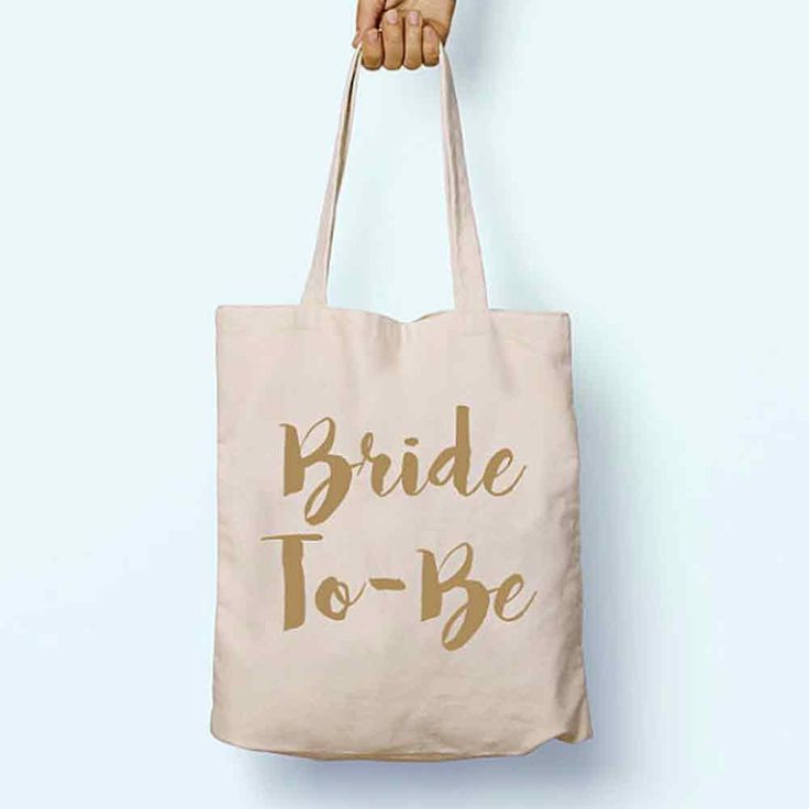 We love the idea of using this bride-to-be tote bag to hold all of your fiancée's presents in – call it the modern day fiancée stocking!