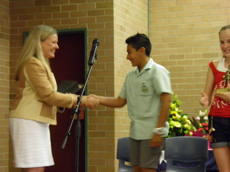 Dux of Menai Primary School for 2013 Dani receiving his award from the Principal Miss Trudy Hopkins