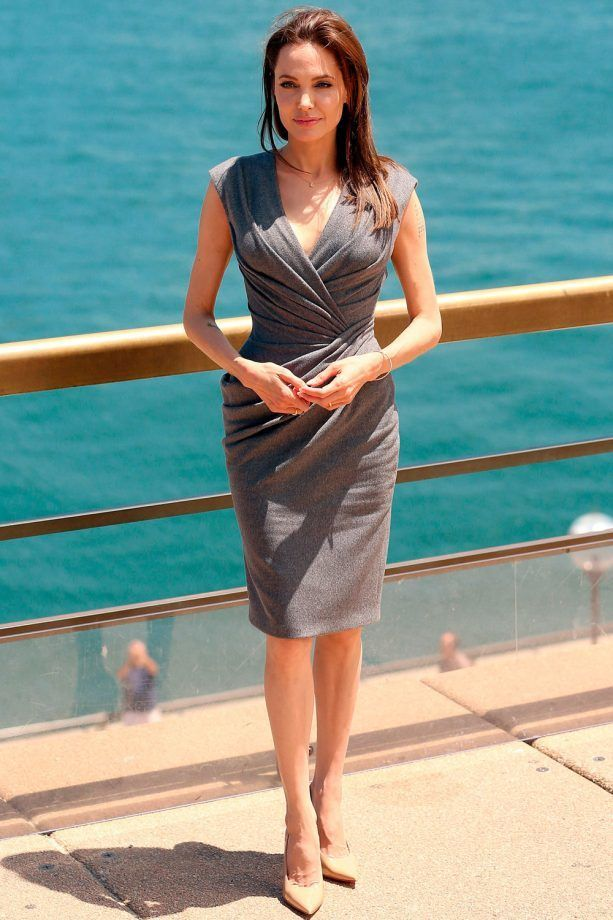 Angelina Jolie Opts For A Grey Wraparound Dress At The 'Unbroken' Film Photocall In Sydney, 2014