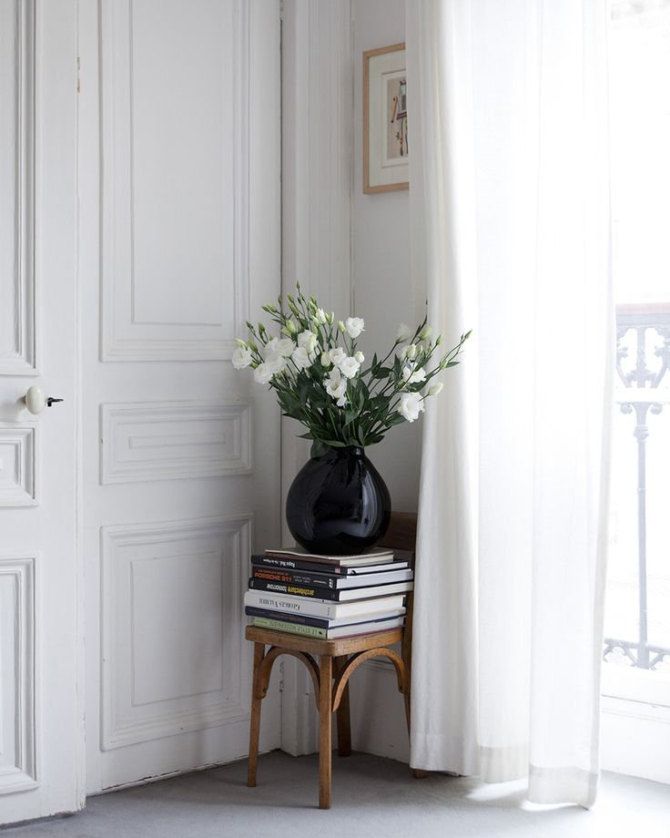 Simple - chair, books, black vase, white flowers, white curtains, white door