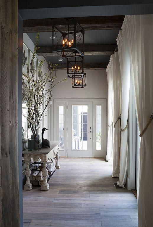Elegant foyer entrance with 14' ceilings and French doors to courtyard - Rehoboth Beach house rental