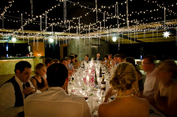 Christmas lights and plastic crystal chains create a magical dinner setting. Find out more at http://thelazybride.com/5-crystal-wedding-decor-ideas/