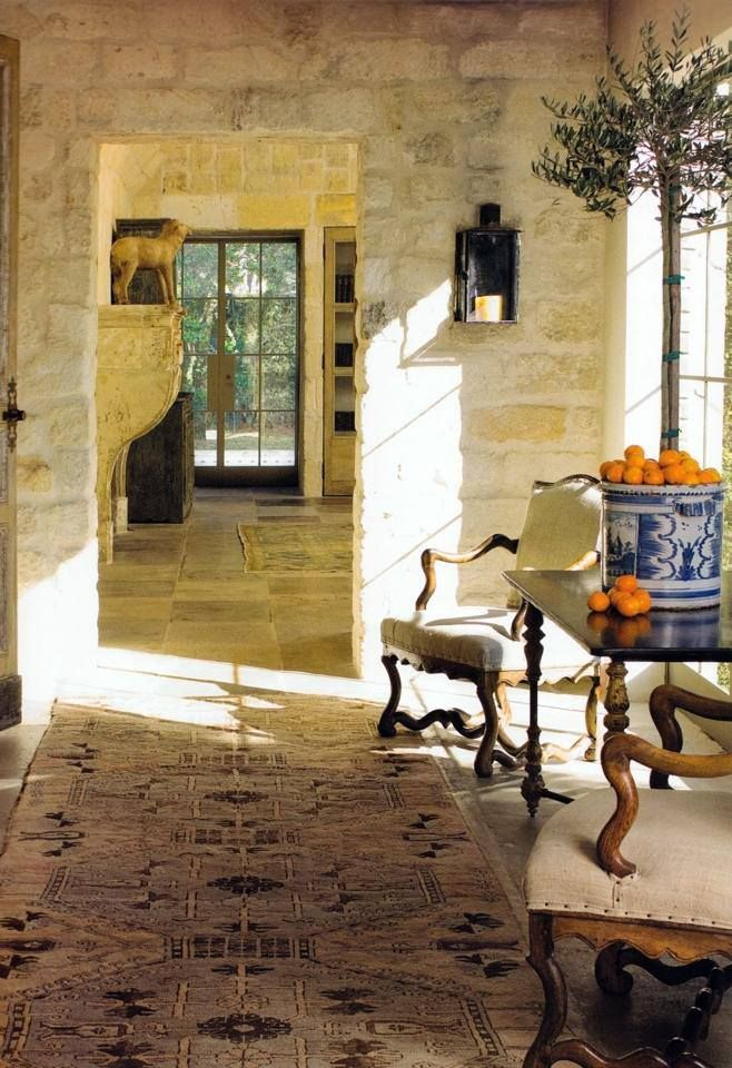 Interior Design with antique stone: mantke, floors and walls.  Beautiful in the sunlight.