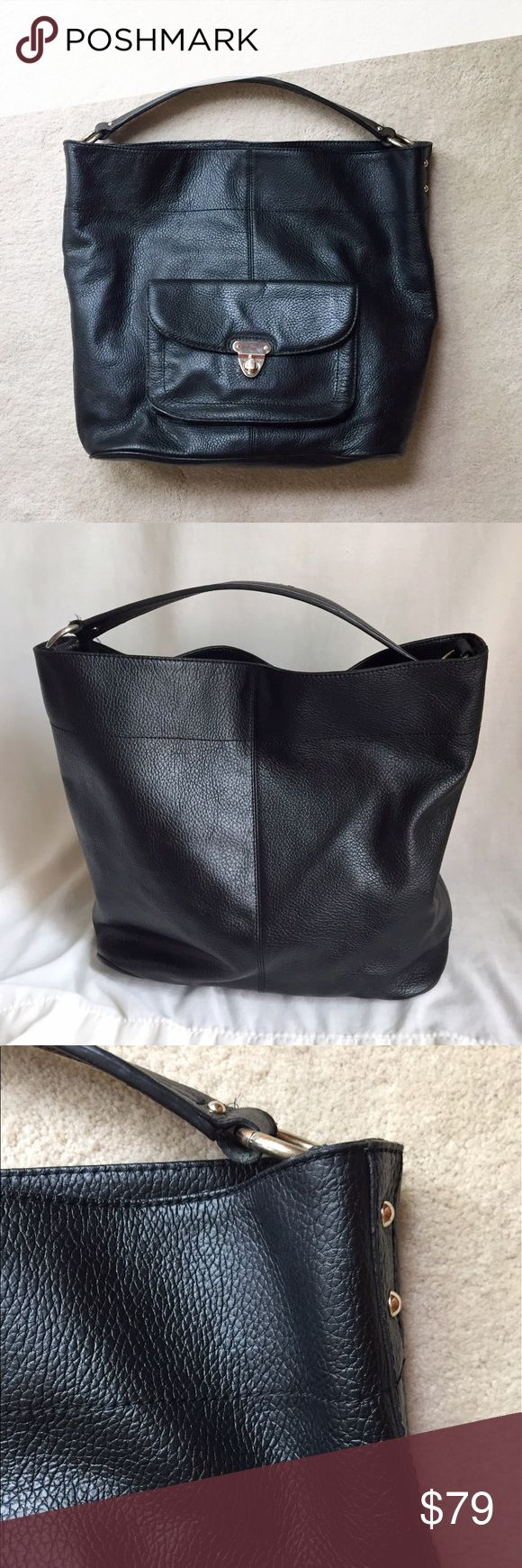 """Banana Republic Black Pebbled Leather Tote The perfect combination of style and function! This large tote bag by Banana Republic looks great and is big enough to carry everything you need. The bag has a front pocket with a gold buckle closure. There is an interior zip pocket and 2 slide pockets. It is made of 100% leather and is fully lined. It is 13"""" high, 15"""" wide, and 6"""" deep. The handle has a 7"""" drop. Banana Republic Bags Totes"""