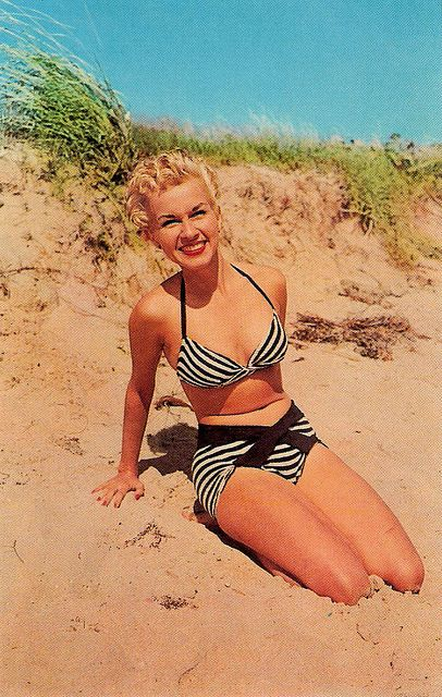 Stripes, smiles, and cute curls at the beach during the 1950s. #vintage #beach #summer #1950s #bikini #hair