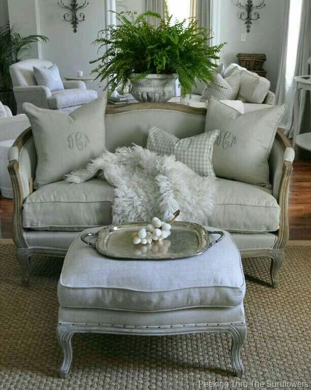 Lovely ottoman in front of sofa.