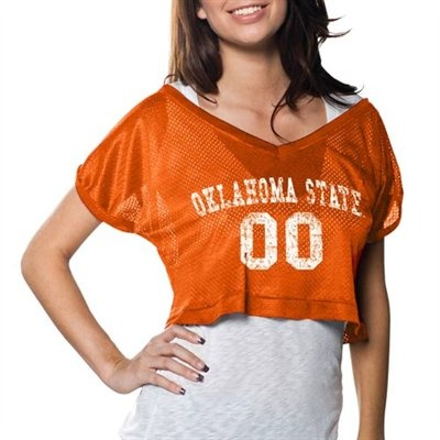 Ladies, don't default to a standard T-shirt for the next Oklahoma State game; perk up your game day apparel with this flirty cropped V-neck jersey top! Made of a team-colored mesh jersey material, it flaunts a distressed university name and generic number printed on the front, rolled-up loose-fitting sleeves and a super-short hem line for a playful, trendy expression of your stunning Cowboys spirit!