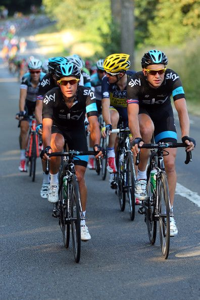 Peter Kennaugh of Great Britain and SKY Procycling (L) and teammate Ian Stannard of Great Britain lead the pack during the twenty first and final stage of the 2013 Tour de France, a processional 133.5KM road stage ending in an evening race around the Champs-Elysees, on July 21, 2013 in Paris, France.
