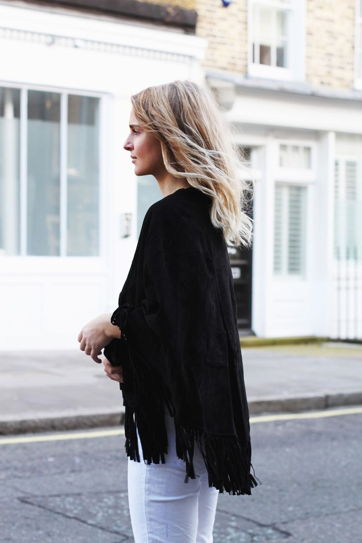 Fringe+Fashion+Trend:+Mirjam+Flatau+is+wearing+a+black+Maje+fringed+poncho