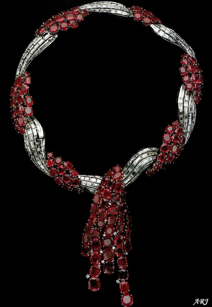 """The Duchess of Windsor's Ruby Set: The necklace was designed by Rene-Sim Lacaze and executed by Van Cleef & Arpels in 1938. The clasp is engraved with a loving inscription from the Duke: """"My Wallis from her David, 19.VI.1936""""."""