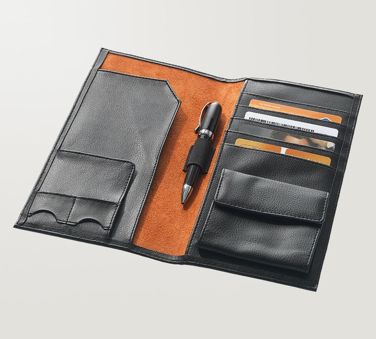 The executive travel wallet from Balmain is a stunning black imitation leather wallet for your passport. This is a great executive business gift idea.