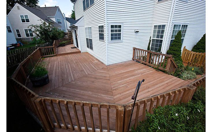 A Wrap-Around Deck Makeover featuring Enhance® in Clam Shell & Beach Dune - Trex
