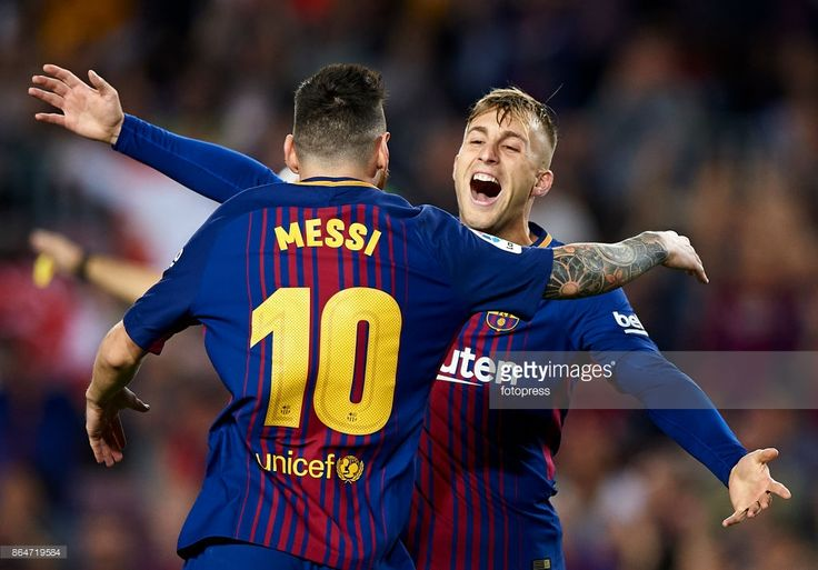 Gerard Deulofeu (R) of Barcelona celebrates with Lionel Messi of Barcelona after scoring the first goal during the La Liga match between Barcelona and Malaga at Camp Nou on October 21, 2017 in Barcelona, Spain.