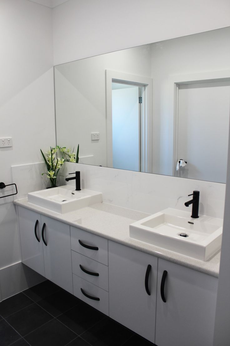 Vanity with Snowdrift gloss doors, Pure Mineralstone benchtops with black fittings