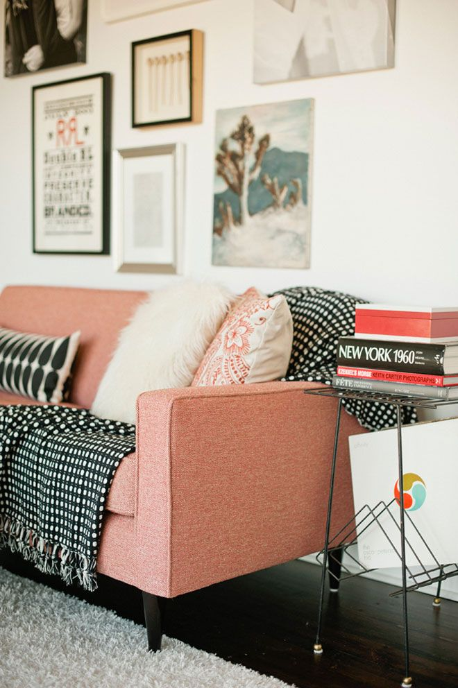 ETC INSPIRATION BLOG DESIGN INTERIOR SWEDISH MID CENTURY INSPIRED PINK SALMON COUCH SOFA BLACK WHITE GRAPHIC PRINT BLANKETS PILLOWS FRAMED WALL PICTURES PHOTO BOOKS METAL SHELF FURRY FUZZY WHITE RUG MONGOLIAN FUR THROW PILLOW JEREMY HARWELL PHOTOGRAPHER