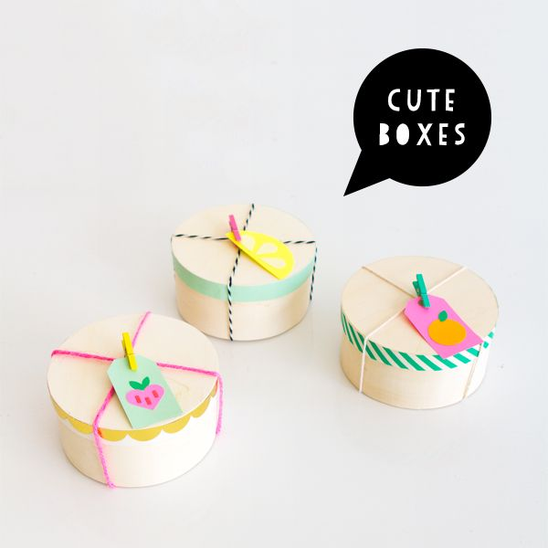 Cute boxes with washi tape and tutti fruitti punch tags (via Oh Happy Day!).