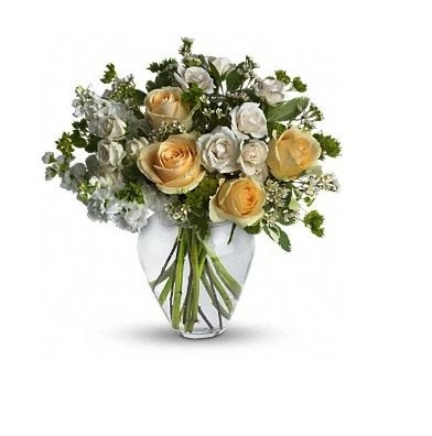 Celestial Love : It is peaceful and pure. This pretty arrangement of white and light colors will let anyone know they are in your thoughts. Fresh flowers such as peach roses, creme spray roses and more are gathered in a beautiful clear vase. For more details visit site.. http://www.dreamflowershouston.com/product/celestial-love-246