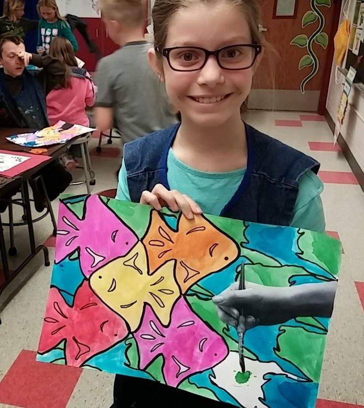 Fourth graders got to do this neat mind bending project. We began by looking at the work of MC Escher who loved both math (geometry) and art. As you can see he did very planned and precise artwork!