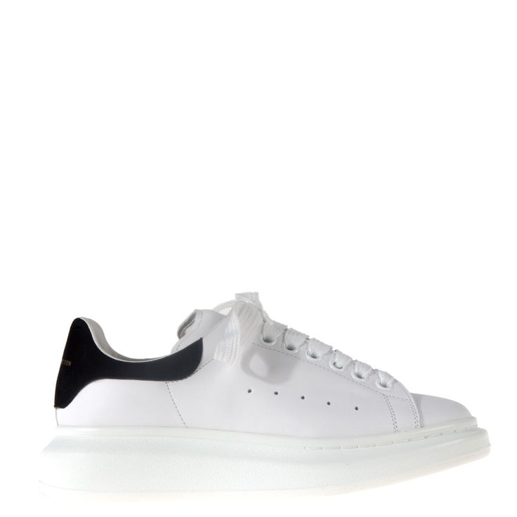 Classic white lace-up sneakers from Alexander McQueen. Crafted from calf leather, they feature a comfortable rubber sole, rounded toe and perforated air holes on the vamp. Logo on the tongue and back counter. Kid leather lining. Perfect to complete your casual look.