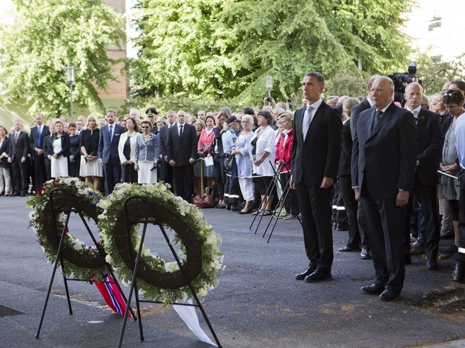 Norwegian Prime Minister Jens Stoltenberg (foreground left) and King Harald (foreground right) attend a memorial ceremony near a government building damaged by a bomb attack in Oslo, Norway, Sunday.