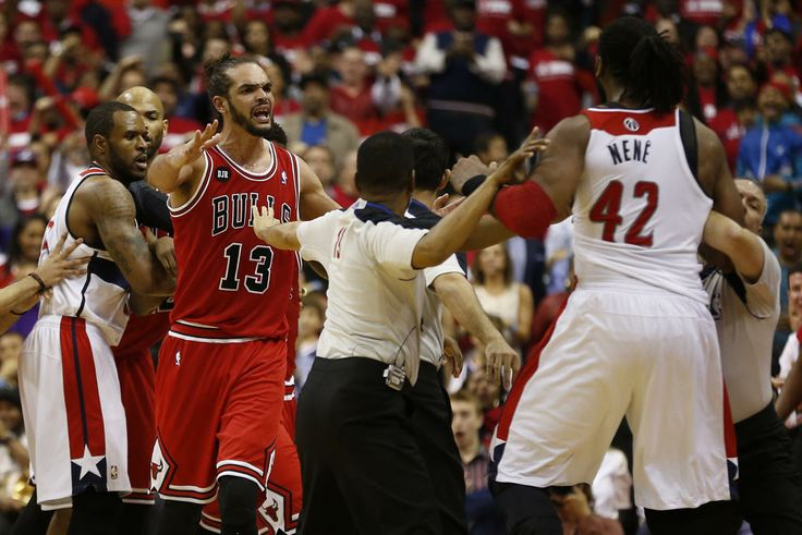 Apr 25, 2014; Washington, DC, USA; Chicago Bulls center Joakim Noah (13) attempts to intervene in a scuffle between Washington Wizards forward Nene (42) and Chicago Bulls guard Jimmy Butler (21) in the fourth quarter in game three of the first round of the 2014 NBA Playoffs at Verizon Center. (Geoff Burke-USA TODAY Sports)