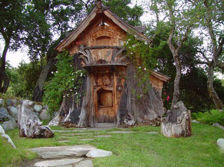 Cottage carved from a redwood tree stump, by Steve Blanchard, chainsaw artist: the cottage isn't inhabitable and is featured as a work of art. Still a cute idea for a small home.