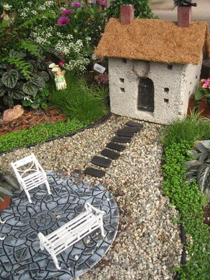 Idea: use a concrete block and turn it into a house in a fairy garden