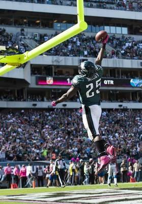 Eagles running back LeSean McCoy celebrates scoring a touchdown.