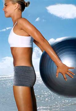 Ball Lift:  Stand with feet hip-width apart, holding a stability ball behind you an inch from butt. Keeping chest up, draw abs in tight, squeeze shoulder blades together and raise ball behind you (as shown); lower to start. Do 20 lifts.  WORKS ABS, BACK, TRICEPS! THIS WORKS, BURNS BOTTOM PART OF ABS & ARMS!