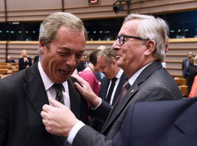 Before and after Brexit: Photo highlights of British politics in 2016:      Brexit:   United Kingdom Independence Party (UKIP) leader Nigel Farage reacts as he meets European Union (EU) Commission President Jean-Claude Juncker ahead of a plenary session at the EU headquarters in Brussels on 28 June 2016.   John Thys/AFP