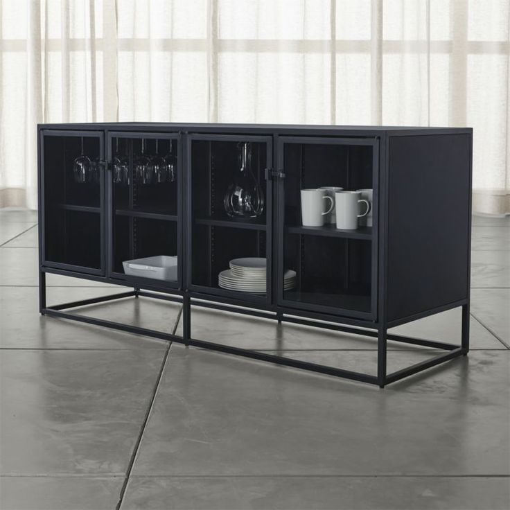 Shop Casement Black Large Sideboard.   Designed by Paul Schulman of Schulman Design, its black steel frame is latched with simple industrial hardware.  Showcase prized pieces on adjustable shelves, or display them along the top ledge.