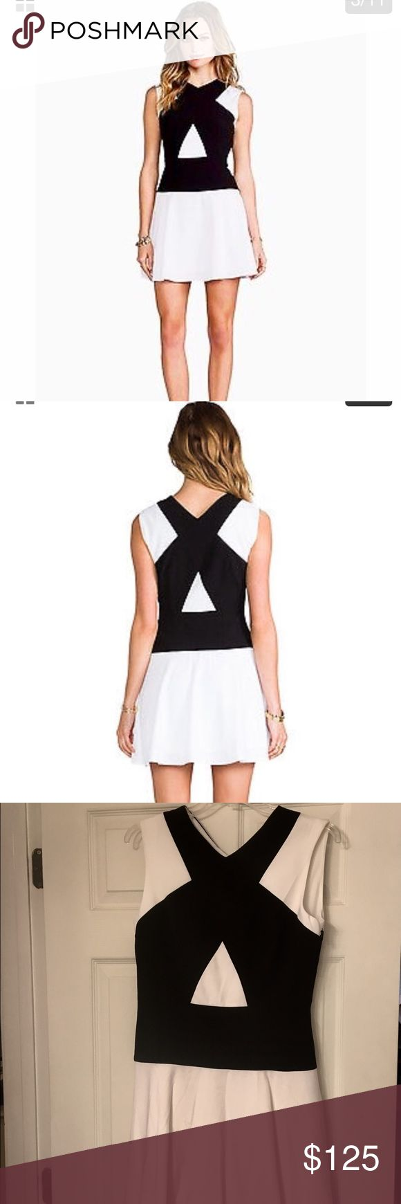 ⚫️Black and white mini dress⚫️ This dress speaks for itself. It's gorgeous and is perfect for many occasions. Brand new, never worn. Mint condition. Zips up the side. BCBGMaxAzria Dresses Mini