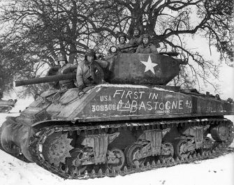 • The five-man crew of the M4A3E2 Sherman Jumbo assault tank Cobra King poses for a triumphant photo with their siege0-breaking war machine. NATIONAL ARCHIVES