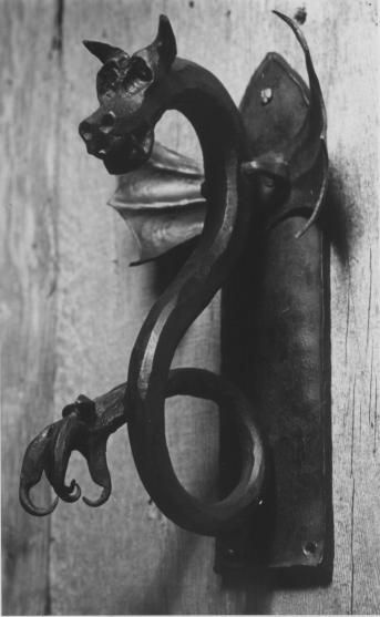 Dragon door knocker: Ironwork by Mike Spencer, blacksmith. That ol' classic of the blacksmiths, but a door knocker rather than a poker.