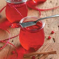 """Candy Apple Jelly Absolutely the prettiest and tastiest jelly ever. """"Dressed up,"""" this homemade goodie is perfect for your friends and family on your gift-giving list. Try tying an old-fashioned spoon on the jar with red-and-white checked gingham - splendid!"""