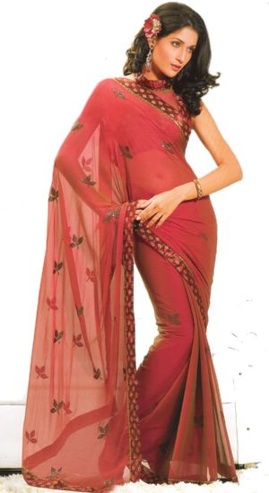georgette saree. Has embroidered motifs o it ad a embroidered border. Comes with a matching blouse material