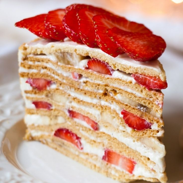 A sweet and fancy layer cake that is filled with whipped cream and fruit then topped with a vanilla glaze.. Mile High Strawberry Cake Recipe from Grandmothers Kitchen.