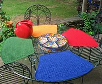 Ravelry: Mesa de Fiesta Placemats pattern by Maria Lee $4.25  It's a party on the patio!  Perfect for any round table but especially appropriate for a summer place setting outdoors.  These crochet placemats work up quickly - make one in just a couple of hours. The stitch pattern provides great texture and makes the mats reversible for longer use before washing. A set of these placemats in a sturdy cotton will grace your table for many seasons.