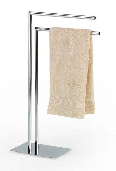 Držák na ručníky STYLE s obdélníkovou základnou a dvěma rameny ve tvaru L. Elegantní držák má gumové nožičky na spodní straně pro zajištění stabilní pozice. Držák na ručníky je zhotoven z chromovaného kovu.