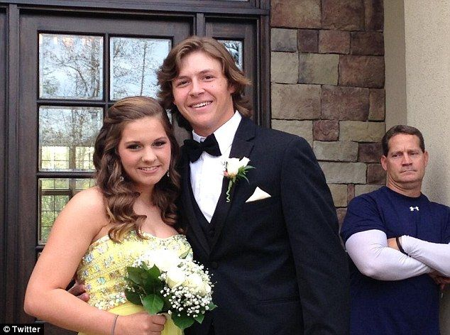Dad's not impressed. College football coach caught throwing his daughter's prom date a disapproving glance.