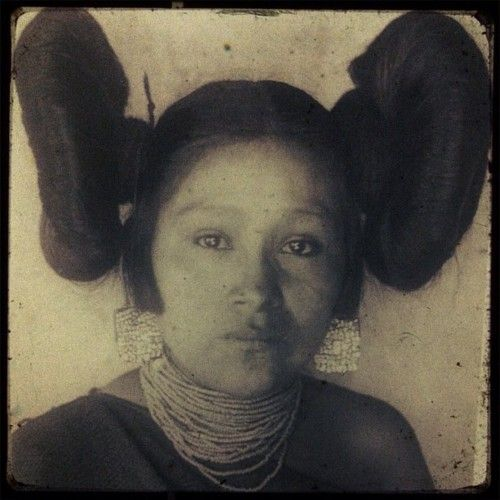 The butterfly hairstyle: just one of the many aesthetics Star Wars did NOT invent.    This is an image is of a Hopi woman taken in 1901. She wears turquoise mosaic earrings, a necklace of glass seed beads and a traditional black manta. Her butterfly hairstyle is a typical hairstyle of women who were ready for marriage but not yet married.
