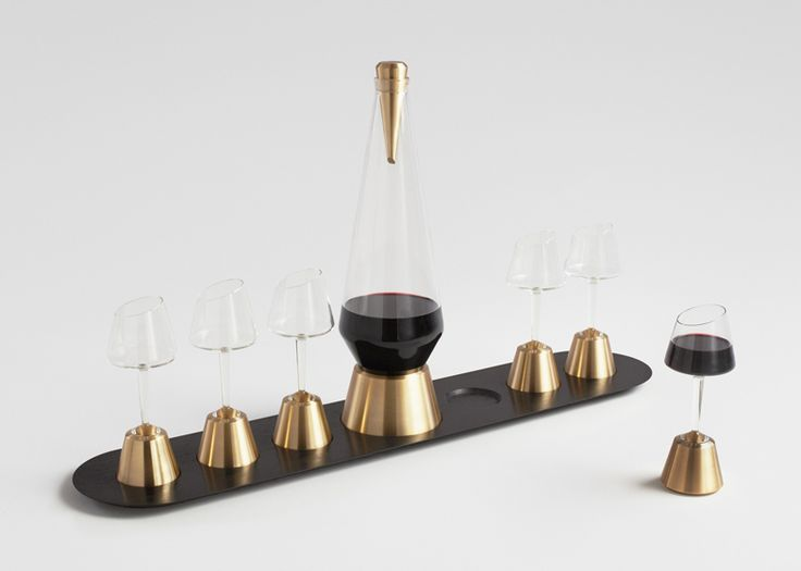 A port decanter set that encourages users to constantly share the drink around