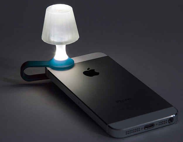 A teeny tiny lamp powered by your phone's flashlight.