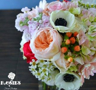 Fall wedding bouquet including anemone, hypericum berries, garden roses, roses, wax flowers, stock, hydrangea, gerbera daisies, & alstroemeria. Wedding flowers and photography by Rosie's Floral Boutique.