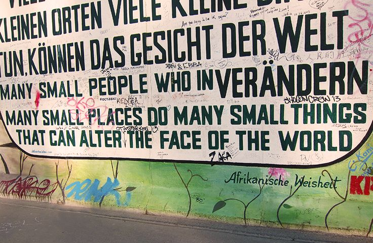 """Berlin Wall: """"Many small people who in many small places do many small things that can alter the face of the world."""" Photo: Veronica Louis"""